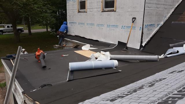 Waterford, CT - EPDM rubber membrane is down and the new GAF Roof system is being installed.