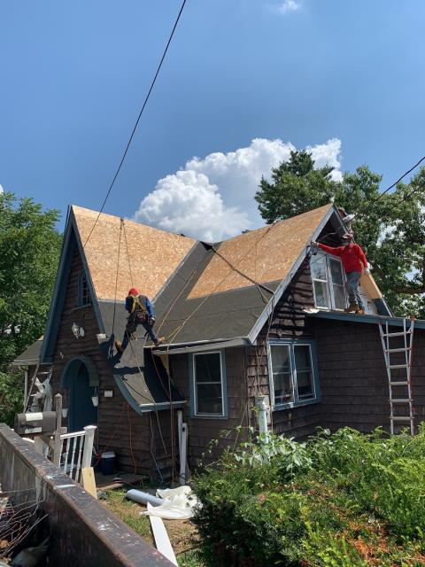 Griswold, CT - Back in Griswold ct replacing this roof. A mason was called to the property to remove the old chimneys. Now our roofers are back installing new sheathing and a new GAF roof system using GAF Timberline HDZ roof shingles.