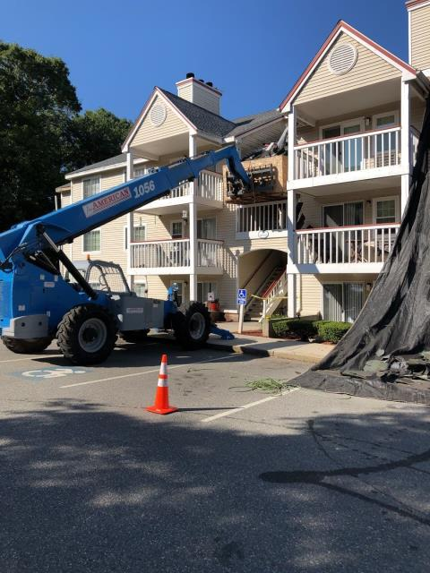 Jupiter Point, CT - Roofing crew is removing another section of old shingles and siding on this condominium in groton Ct. A new GAF roof system is being installed. GAF Timberline HDZ roof shingles.