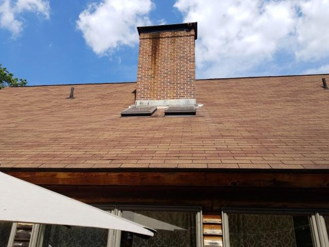 Glasgo, CT - Measuring this three tab roof that needs to be replaced in Voluntown CT. New Velux skylights. A full Roof replacement is recommended using GAF Timberline HDZ roof shingles. 50 Year warranty! Zero Percent financing available.