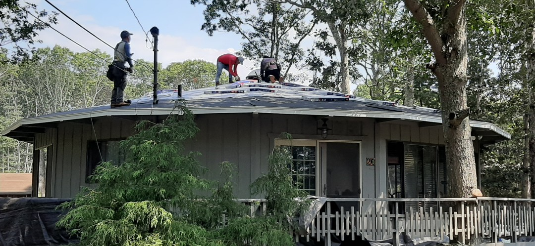 Charlestown, RI - Crew has finished prepping house with GAF accessories,  and are now bringing bundles of shingles to the roof. They should be shingling soon.