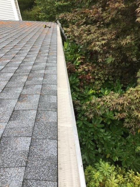 Richmond, RI - Installing new Stainless steel gutter guards in Richmond RI today. First we installed a new GAF Roof system.