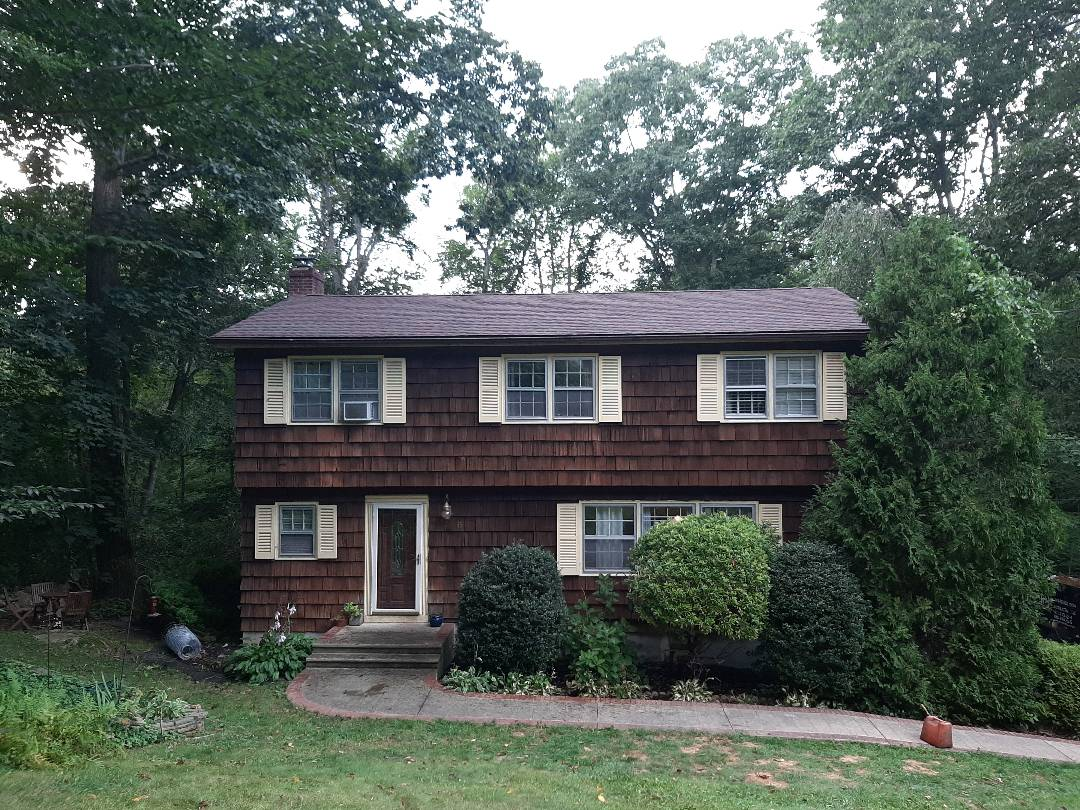 Ledyard, CT - All done. Home is now covered with a GAF roof system, which includes Timberline HDZ Architectural shingles in Hickory.