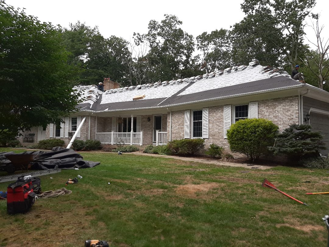 Hopkinton, RI - Roof is prepped with GAF feltbuster synthetic paper, and weatherwatch ice/water. Timberline Ultra HD Architectural shingles have been loaded up on roof. It's time to lay shingles