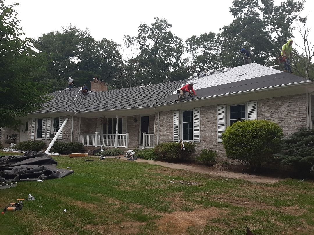 Hopkinton, RI - We're almost done with this 53sq home. Guys are installing the Timberline Ultra HD in Pewter Gray. Homeowner chose the GAF Weather Stopper Golden Pledge Warranty, so these shingles are covered for 50 years, and the workmanship for 25 years!