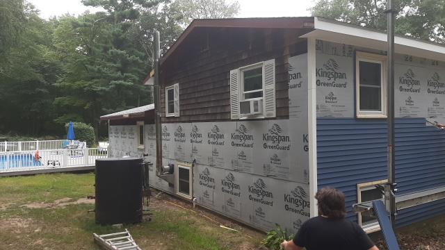 Hopkinton, RI - Checking on progress at one of our vinyl siding projects currently being done. Installing new insulation board and new vinyl siding. New seamless gutters will be installed.