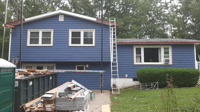 """Hopkinton, RI - Here is One of our current vinyl siding projects in RI. This customer went with Mastic  Double 7"""" cedar impressions, color Newport Bay. custom bent aluminum will be completed soon. New seamless gutters"""