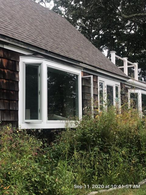 Stonington, CT - Measuring this property for new seamless gutters and gutter guards. No more gutter to clean after both are installed.