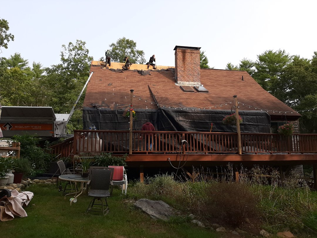 Voluntown, CT - Working in Voluntown, CT today. Here the crew is stripping the old shingles, which will be replaced with a GAF roof system.