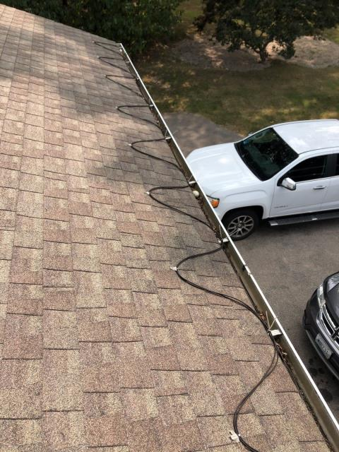 Charlestown, RI - After this roof is replaced using GAF Ice & Water and GAF HDZ roof shingles it will no longer need these heat cables to prevent ice damming. When ice & water is installed properly to code ice damming is not a issue.