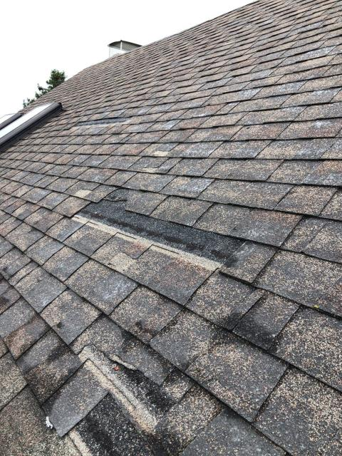 East Lyme, CT - High winds can cause damage like this to your roof! During a full roof inspection on this roof we found missing shingles. Homeowners insurance has been notified. A new GAF Timberline HDZ roof shingle is recommend. Unlimited wind  warranty.