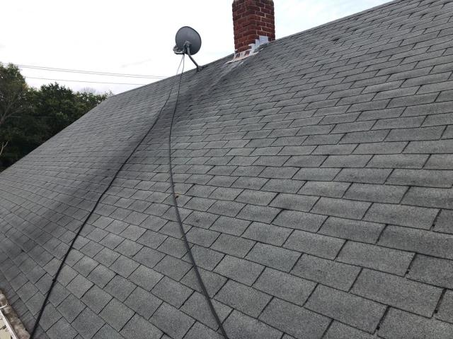 Norwich, CT - Measuring this roof for a full replacement. New plywood will need to be installed. A new GAF Timberline HDZ roof shingle is a great option. Chimney will need to be rebuilt by a mason.