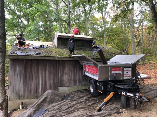 Voluntown, CT - Our roofing crew is in Voluntown Ct  using the Equipter to catch all the roofing debris without even hitting the ground! This detached garage will be completed using all GAF roofing accessories and GAF Timberline HDZ roofing shingles.