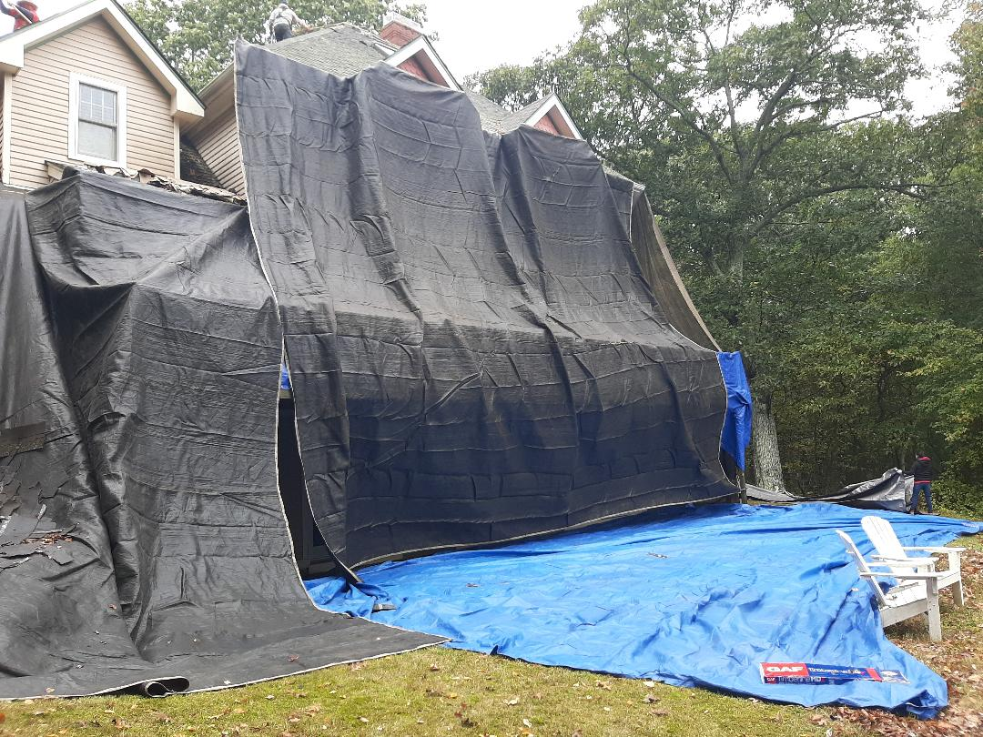 South Kingstown, RI - Working in South Kingstown today. We're doing a full roof replacement. Crew is setting up tarps to protect home and plants. Once set up the stripping will start and then we can inspect roof deck for damages.