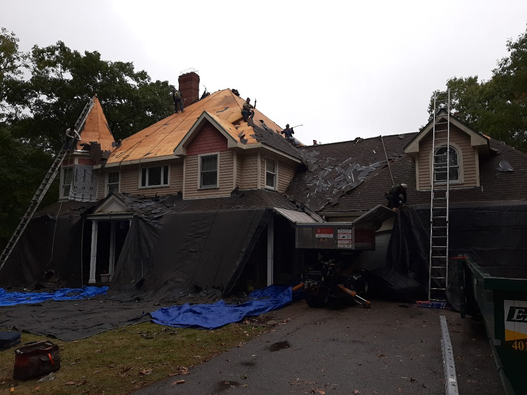 South Kingstown, RI - Crew is cranking stripping away old shingles. Once completed we'll be installing a GAF weather stopper roof system.
