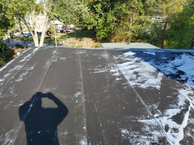 Norwich, CT - Commercial roof inspection in Norwich CT. this old flat roof is leaking and needs to be replaced. Recommend using a new EPDM rubber roof system.