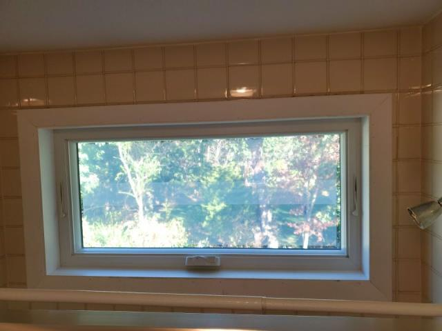Johnston, RI - Installing new interior trim on these new Anderson Windows that we just installed in RI. New vinyl siding and seamless gutter will be installed next.