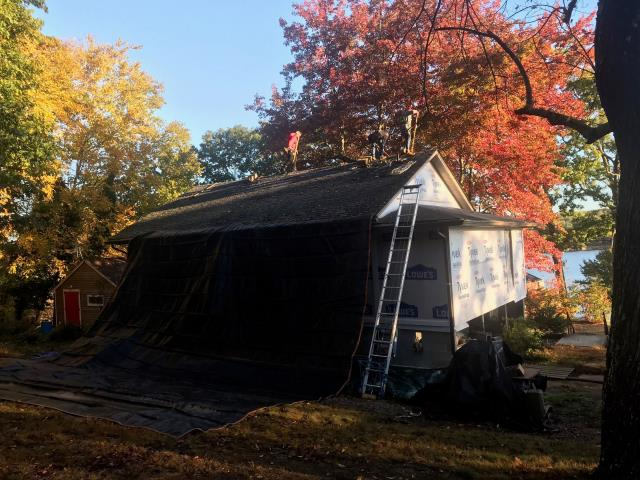 Voluntown, CT - One of our roofing crews in Voluntown CT today starting another roof replacement project! All new GAF Timberline shingles and all of GAF'S accessories will be used on this new roof. First crew is setting up heavy duty tarps to protect the home.