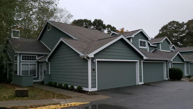 Groton, CT - Another commercial condo in Groton CT has new gutters installed! First a full roof replacement was completed.