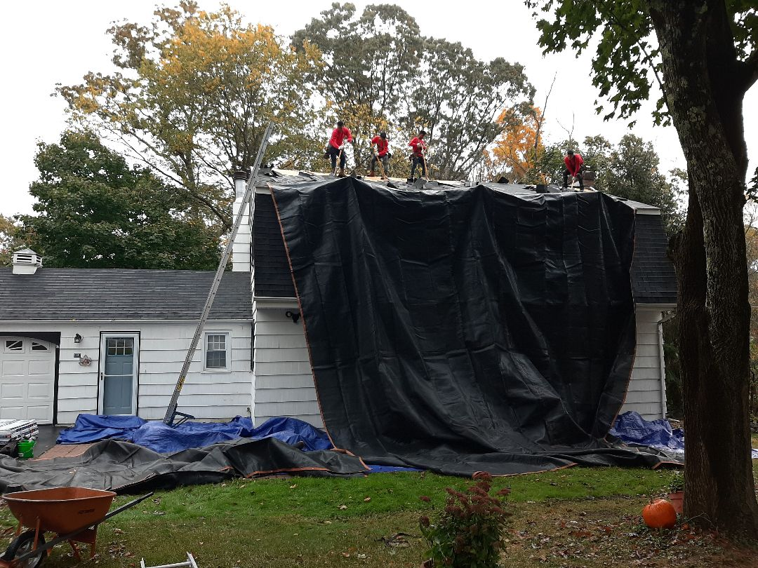 Ledyard, CT - Working in Ledyard, CT today. We're replacing roof due to solar panels being installed. Here the crew is stripping away. Next we'll inspect roof deck.