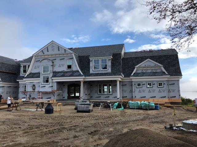 Charlestown, RI - New construction roof installation in progress in Charlestown RI.New Owens corning roof shingles being installed over Grace Ice & Water shield. Full coverage of ice & Water