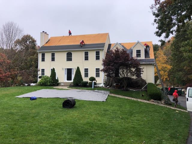Westerly, RI - This roof replacement in Westerly RI is underway! Removing old shingles that were damaged by high winds before installing a new GAF Timberline HDZ roof shingle. High winds caused the roof shingles to blow off.