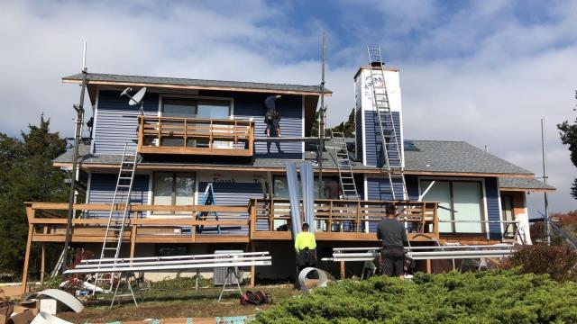 Westerly, RI - Vinyl siding installation is underway in Westerly RI. First the roof was replaced using GAF Timberline roof shingles. Now our siding crew is installing new vinyl siding. No more painting the wood siding! Low maintenance siding options. New seamless gutters next