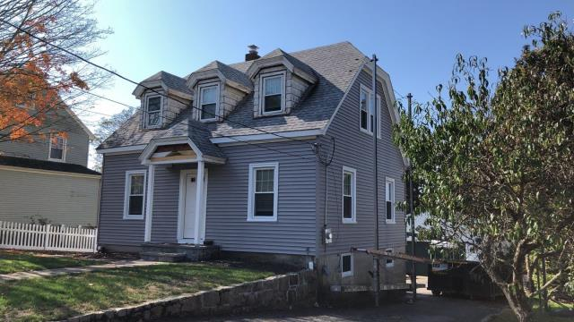 Westerly, RI - This vinyl siding project in Westerly RI is almost complete! New vinyl siding being installed and new seamless gutters.
