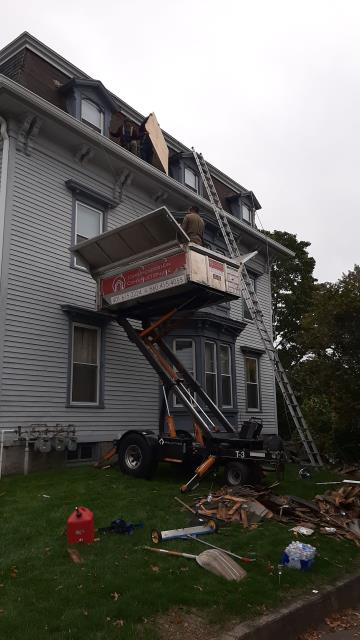 Westerly, RI - Roofers are in Westerly Ri today working on this roof replacement. The equipter is being used to collect the debris and keep this property clean. a new GAGF timberline HDZ roof shingle will be installed.