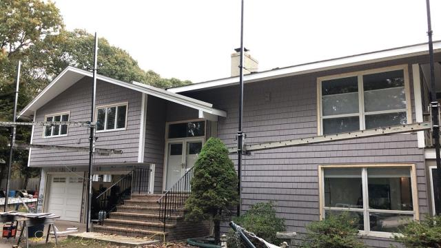 Westerly, RI - Vinyl siding in Westerly RI. Our crew is making great progress on this cedar impression siding job.