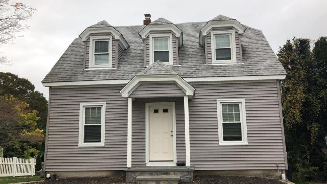Westerly, RI - Just completed another quality vinyl siding installation in Westerly RI! New double four vinyl siding installed. New seamless gutters next