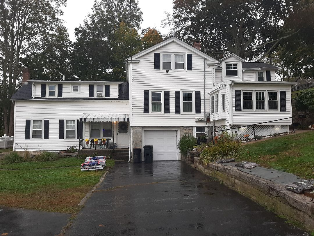 Groton, CT - All done! This home had an entire plywood overlay due to poor roof deck condition. We installed new GAF Weather Stopper roof system, and finished with Timberline HDZ Architectural shingles in Charcoal.