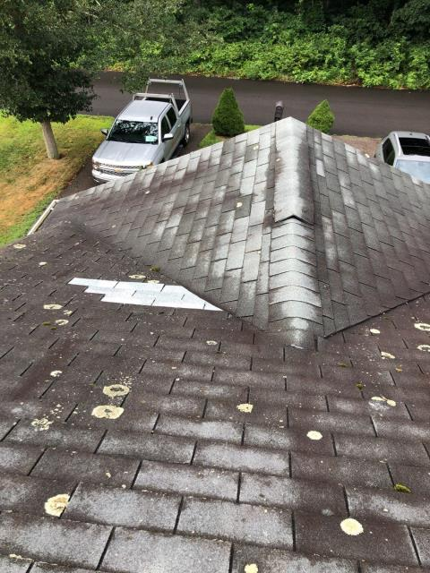 Westerly, RI - This storm damaged roof in Westerly will be getting replaced! Full roof replacement needed to correct the issues with this roof. We will be installing a Full GAF roof system. GAF Timberline HDZ roof shingles.