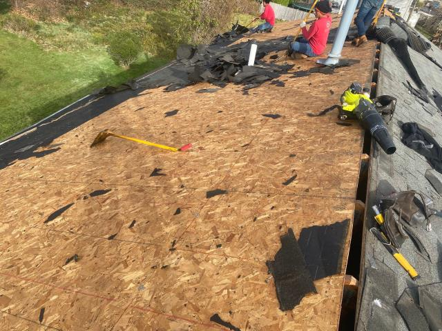 Narragansett, RI - Roofers are in Narragansett Ri today removing the old roof shingles on this home. A new GAF Timberline Roof system will be installed today! New roof in one DAY!