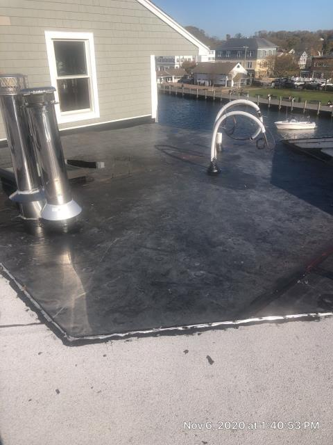Groton, CT - Commercial roof repair in Mystic CT. New EPDM rubber membrane was installed to stop the old roof from leaking.