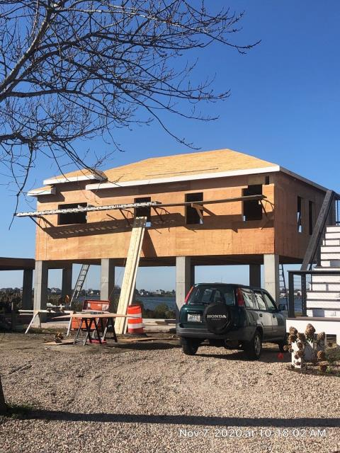 South Kingstown, RI - Measuring for the next standing seam metal roof to be installed in South Kingstown RI. Drexel  standing seam metal roof will be installed on this new home to match the rest of the buildings on this property.