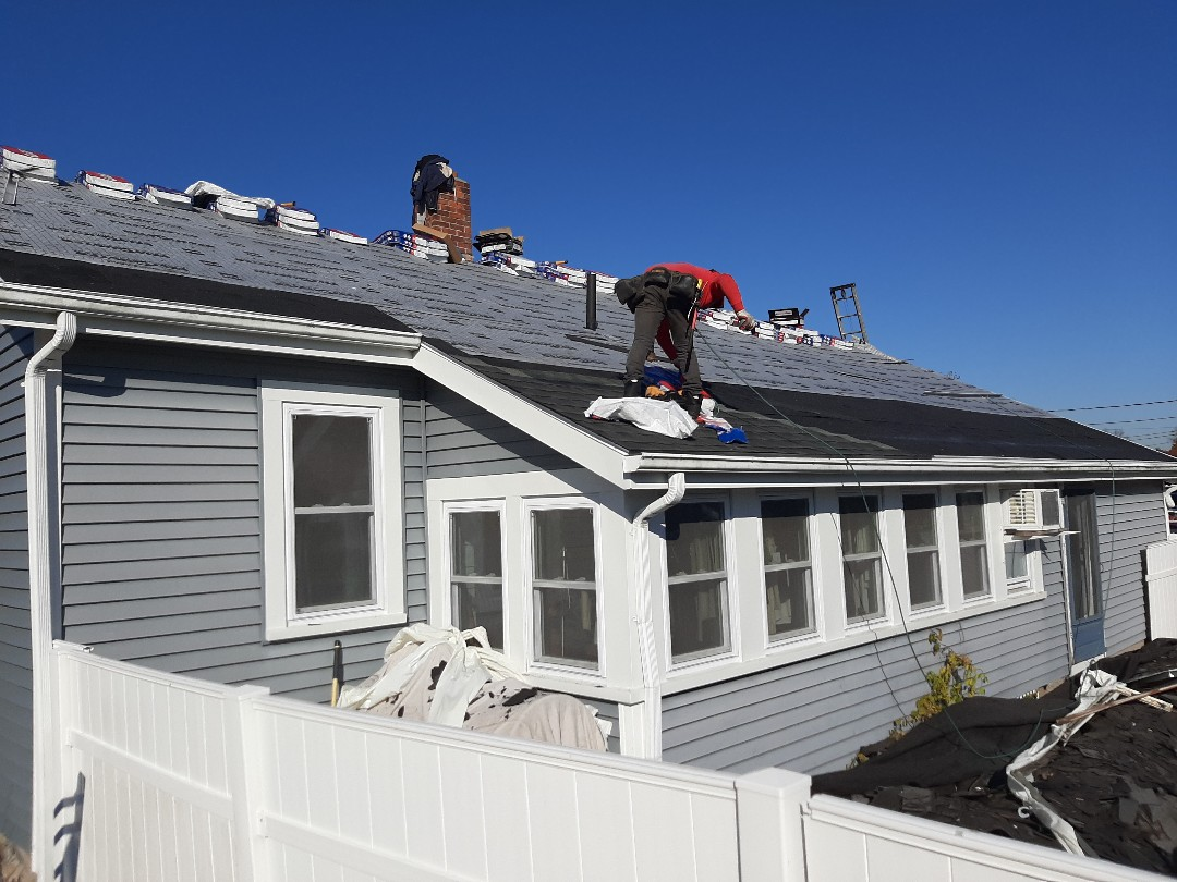 Charlestown, RI - Roof is prepped with GAF accessories, and now crew has begun shingling.