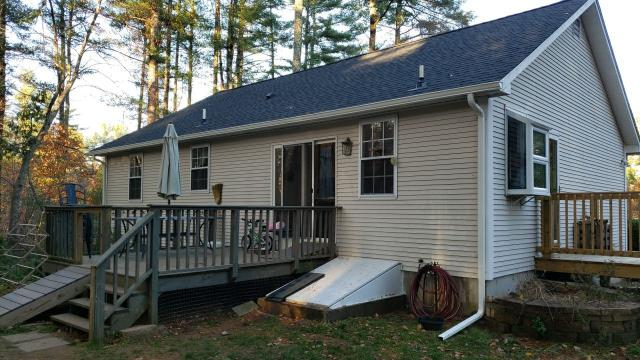 Hopkinton, RI - New white seamless gutter installed with gutter guards in Hopkinton RI. This property also had a GAF roof system installed.
