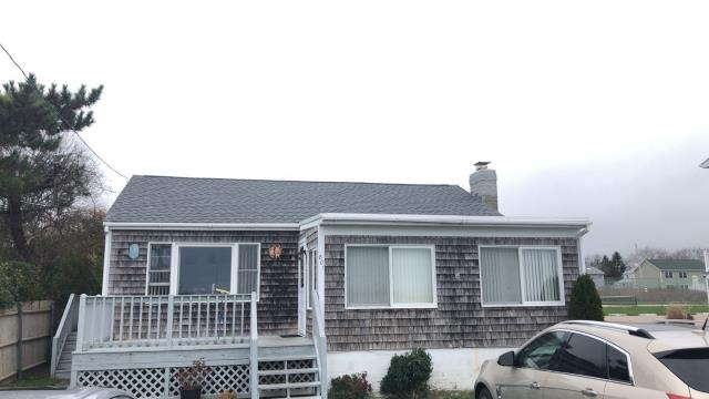 Narragansett, RI - This roof in narragansett RI was just completed. Full roof replacement using GAF roofing shingles. Missing roof shingles from the high wind. Homeowners insurance will cover roof damage ..