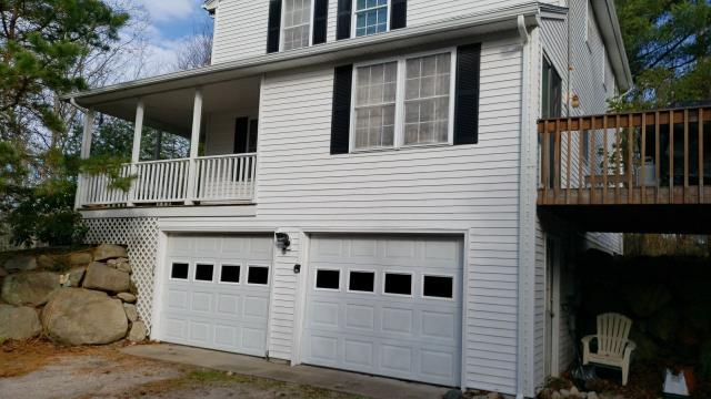 Charlestown, RI - New white seamless aluminum gutters installed on this property in Charlestown RI. Gutter guards