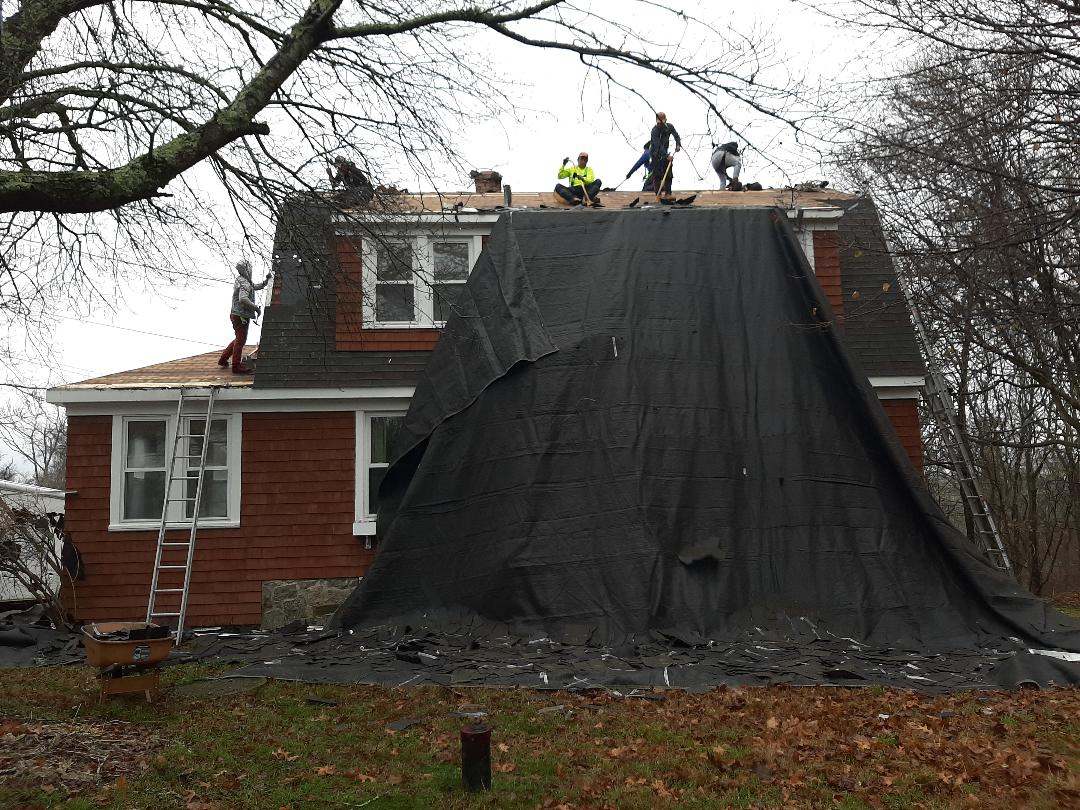 Charlestown, RI - Working in Charlestown today. We're replacing roof shingles with a GAF roof system. Here the crew is stripping old shingles, and once done we'll inspect roof deck.