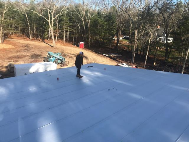 Charlestown, RI - Installing High Temp ice & Water shield on this new home in Charlestown RI. Will be installing a new Standing seam roof system using Drexel Metal.
