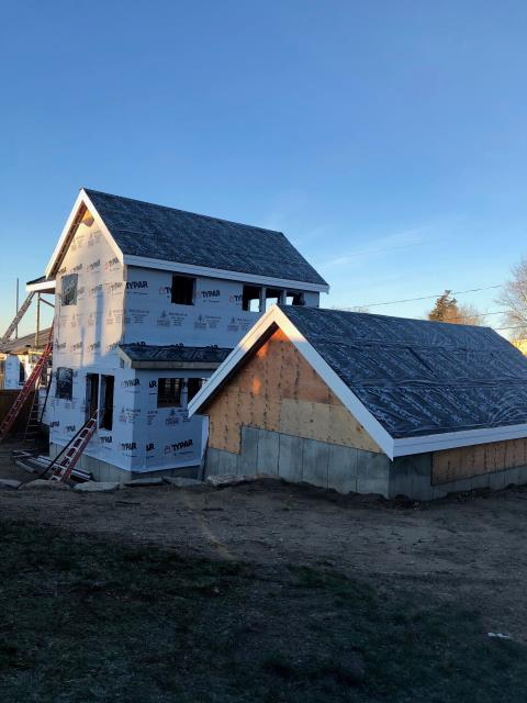 Narragansett, RI - Measuring this new construction roofing project in Narragansett RI for its new roof system.Homeowner is getting a new owens Corning roof system installed.