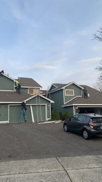 Groton, CT - Siding crew is in Groton Ct installing new siding on this condo. New aluminum trim being installed. new seamless gutters