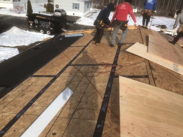 Stonington, CT - Two rows of ice & Water installed for extra protection against ice damming on this low pitch roof. New sheathing being installed. All plywood seams are taped per ct building code. New GAF Roof system to be in stalled next! New roof one day!