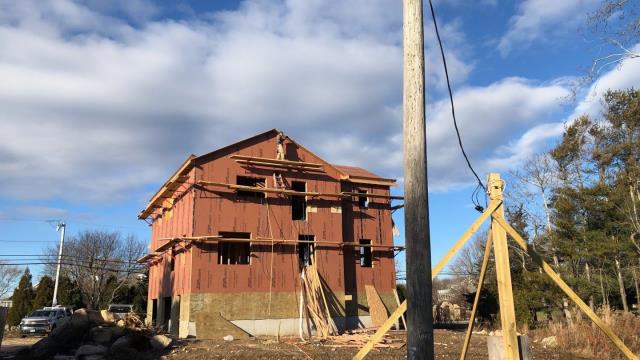 Charlestown, RI - Another new construction roof will be installed on this new home in Charlestown RI. Home owner is going with Owens Corning  duration Roof shingles with a lifetime warranty. Windows will be installed and all the exterior trim.