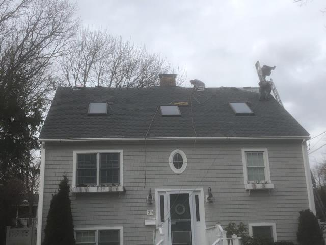 Narragansett, RI - Another quality roof replacement completed today in Narragansett RI using GAF Timberline HDZ  roof shingles. Golden Pledge warranty. Seamless gutters. New Velux skylights.