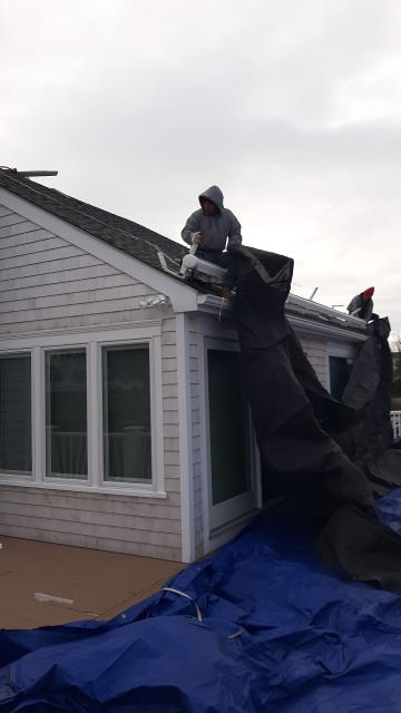 Narragansett, RI - Full roof replacement is getting started today in Narragansett RI. Roofers are setting up tarps to protect the home and property. A new GAF Timberline HDZ roof shingles will be installed using all GAF accessories.