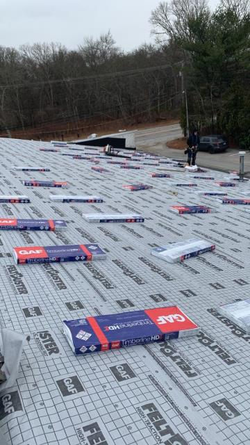 Charlestown, RI - Half of this commercial roof in Charlestown RI is prepped and loaded with the new GAF Timberline HDZ roof shingles. Full roof replacement in Charlestown RI. New roof no mess.