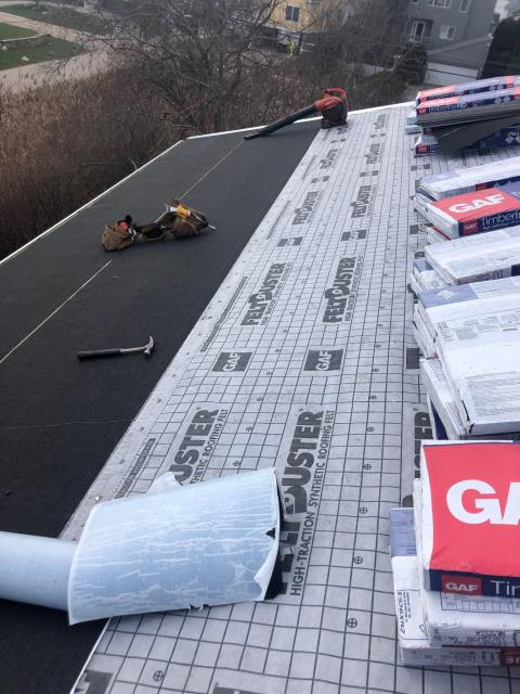 Narragansett, RI - Old roof shingles are all removed and the new GAF Ice & Water shield and synthetic underlayment are installed. All the GAF Timberline Shingles are loaded on the roof and ready to be installed! New roof one day in Rhode Island